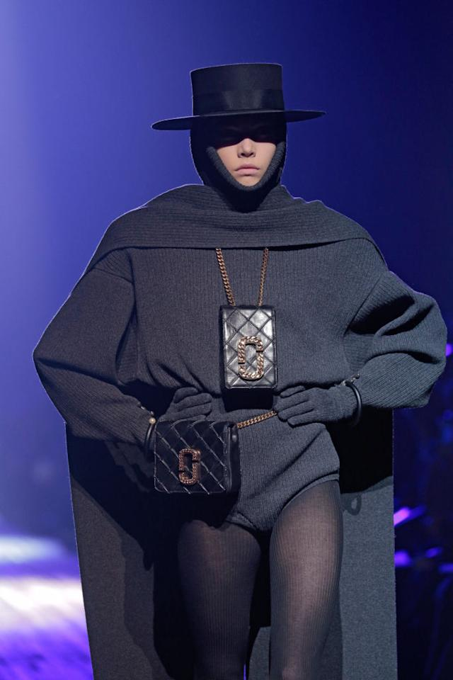 <p>A model wears a black quilted bag necklace and belt bag from the Marc Jacobs FW18 show. (Photo: Getty Images) </p>