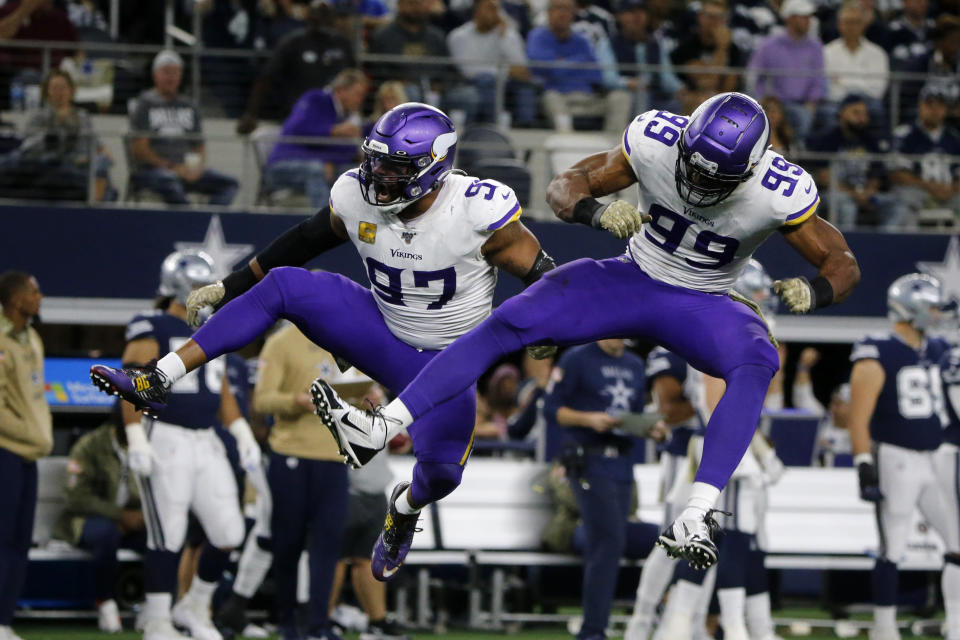 Minnesota Vikings' Everson Griffen (97) and Danielle Hunter (99) celebrate a sack of Dallas Cowboys' Dak Prescott during the second half of an NFL football game in Arlington, Texas, Sunday, Nov. 10, 2019. (AP Photo/Michael Ainsworth)
