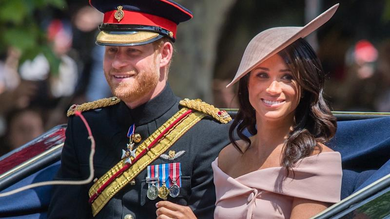 How Prince Harry Helped Meghan Through Her First Ever Balcony Appearance