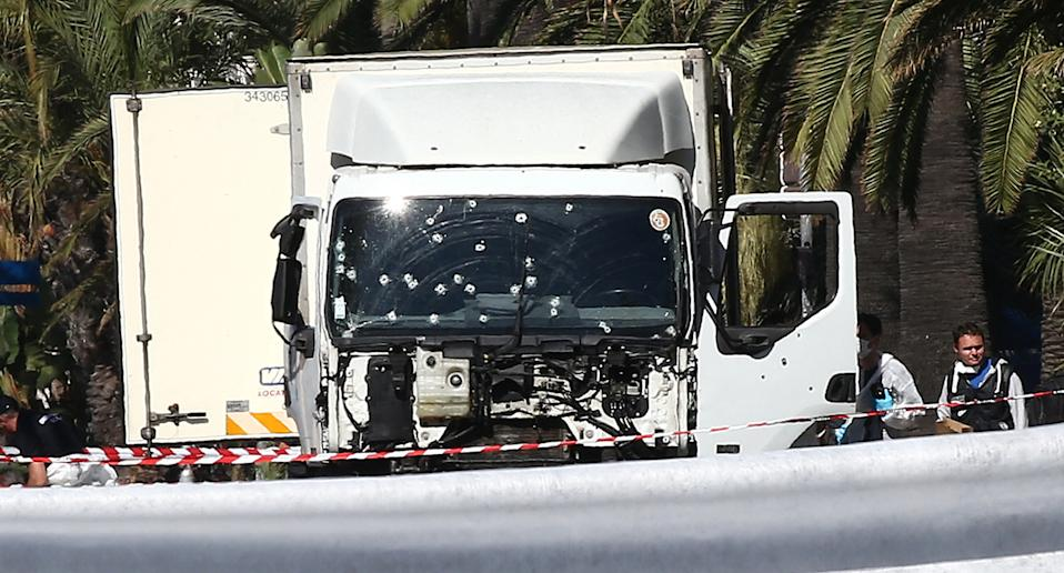 File photo dated July 15, 2016 of torensics officers and policemen look for evidences in a truck on the Promenade des Anglais seafront in the French Riviera town of Nice, after it drove into a crowd, killing 84. France's national anti-terror prosecutors said Thursday they have opened a murder inquiry after a man killed three people at a basilica in central Nice and wounded several others on October 29, 2020. Photo by ABACAPRESS.COM.