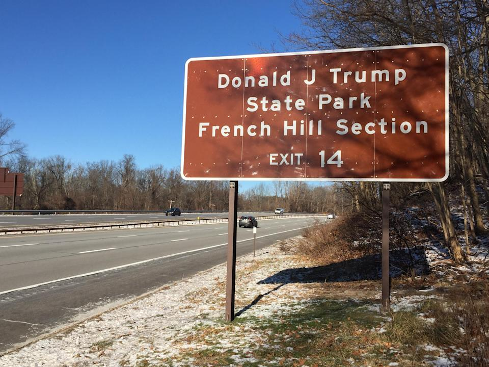 Motorists pass a sign for the French Hill Section of Donald J. Trump State Park, heading north on the Taconic State Parkway in Westchester County, New York. (Photo: Michael Walsh/Yahoo News)