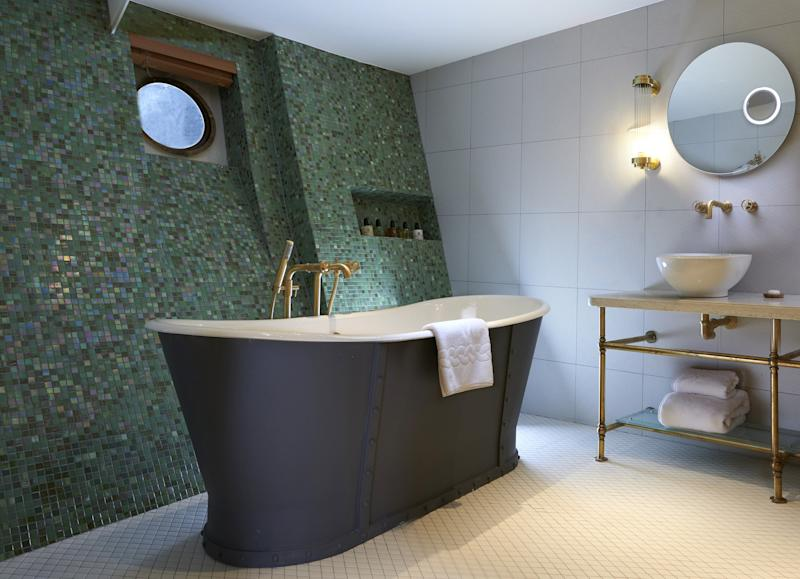 The luxury hotel did not shy away from its seafaring roots during its redesign, as can be seen in the bathroom portholes.
