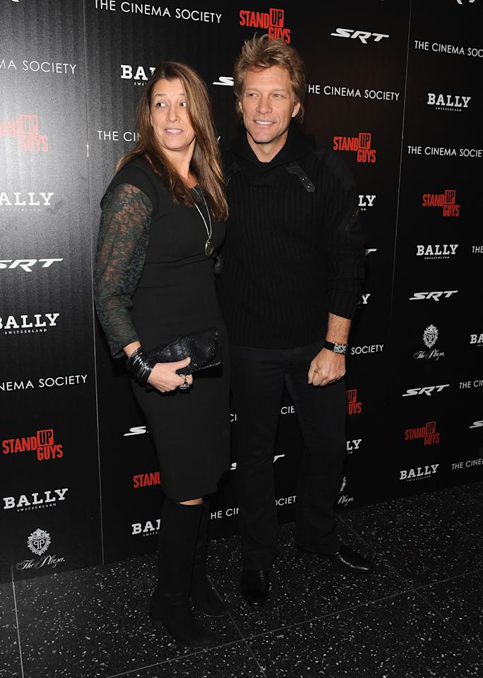 """NEW YORK, NY - DECEMBER 09:  Dorothea Hurley and her husband musician Jon Bon Jovi (R) attend the premiere of """"Stand Up Guys"""" hosted by The Cinema Society with Chrysler and Bally at MOMA on December 9, 2012 in New York City.  (Photo by Fernando Leon/Getty Images)"""