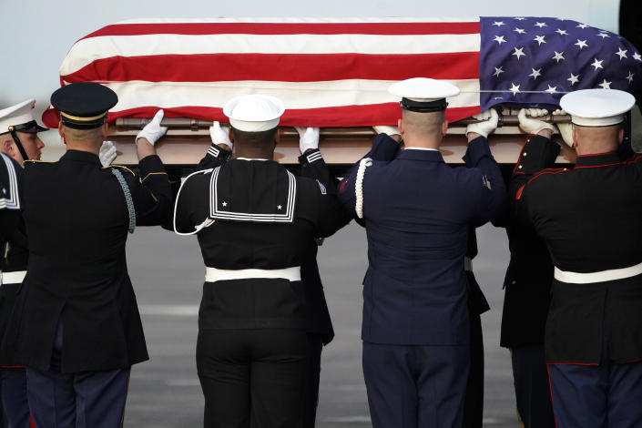 The flag-draped casket of former President George H.W. Bush is carried by a joint services military honor guard Wednesday, Dec. 5, 2018, at Ellington Field in Houston. (Photo: David J. Phillip, Pool/AP)