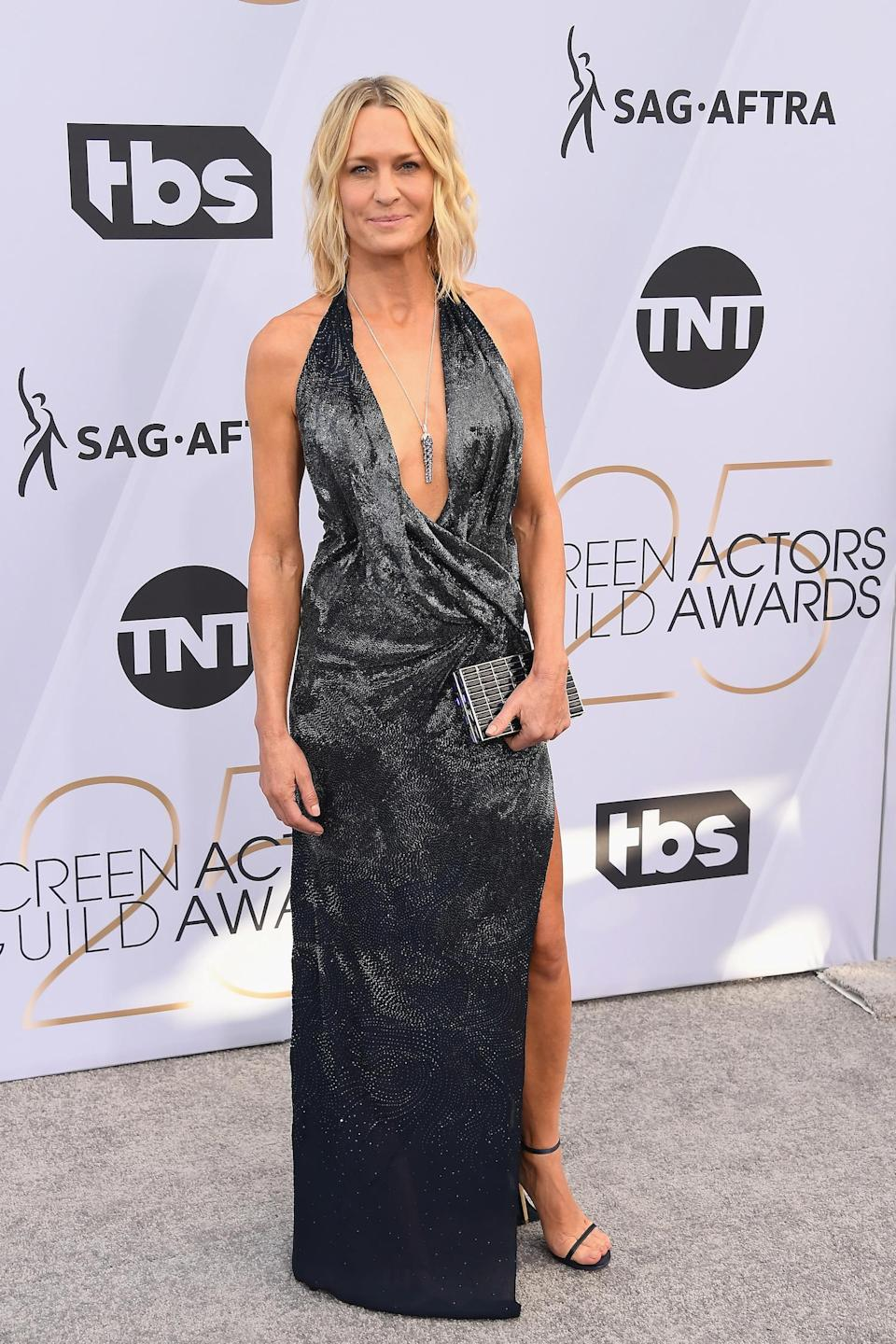 <p>Robin Wright wore a black gown with plunging neckline to the the 2019 Screen Actors Guild Awards in Los Angeles. (Photo: Getty Images) </p>