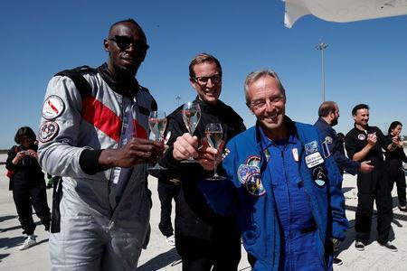 Retired sprinter Usain Bolt, French astronaut Jean-Francois Clervoy, CEO of Novespace, and Quentin Meurisse from Martell Mumm Perrier-Jou't after they enjoyed zero gravity conditions during a flight in a specially modified Airbus Zero-G plane above Reims, France, September 12, 2018. REUTERS/Benoit Tessier