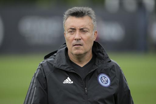 New York City Football Club's manager Domenec Torrent walks over to reporters after practice in Orangeburg, N.Y., Monday, July 23, 2018. (AP Photo/Seth Wenig)