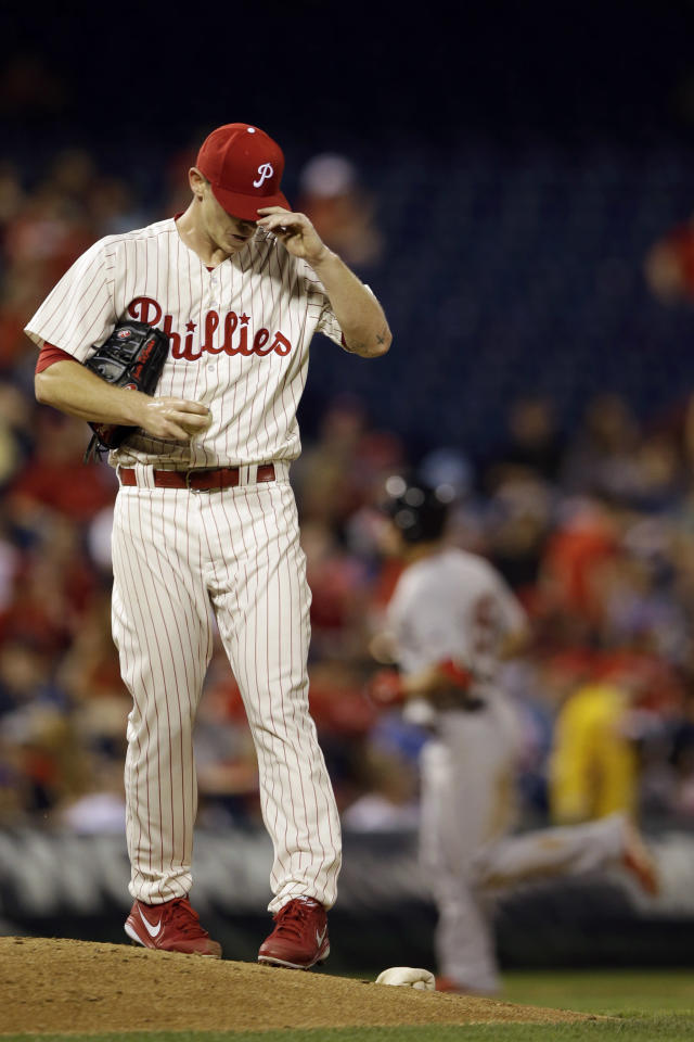 Philadelphia Phillies relief pitcher Justin De Fratus adjusts his hat after giving up a home run to St. Louis Cardinals' Randal Grichuk during the sixth inning of a baseball game, Friday, June 19, 2015, in Philadelphia. St. Louis won 12-4. (AP Photo/Matt Slocum)