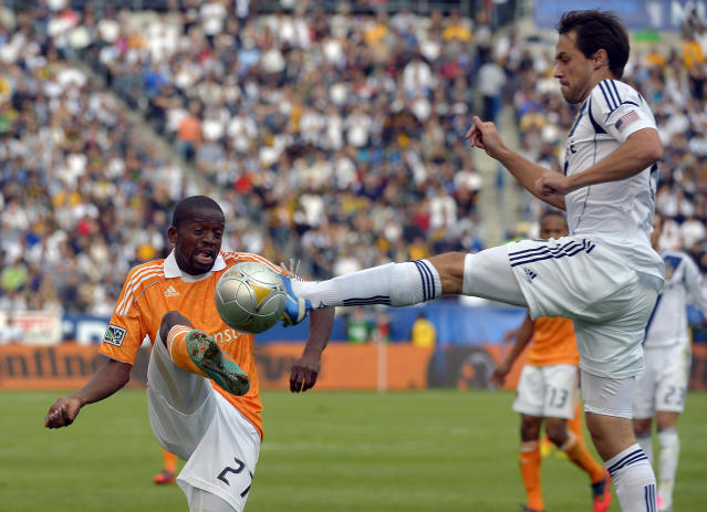 Houston Dynamo midfielder Boniek Garcia, left, and Los Angeles Galaxy defender Todd Dunivant try to kick the ball during the first half of the MLS Cup championship soccer match against the Houston Dynamo in Carson, Calif., Saturday, Dec. 1, 2012. (AP Photo/Jae C. Hong) (AP Photo/Mark J. Terrill)