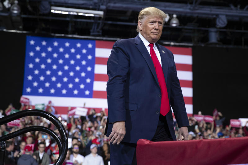 President Donald Trump arrives at Kellogg Arena to speak at a campaign rally, Wednesday, Dec. 18, 2019, in Battle Creek, Mich. (AP Photo/ Evan Vucci)