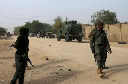 FILE PHOTO: Nigerian military secure the area where a man was killed by suspected militants during an attack around Polo area of Maiduguri
