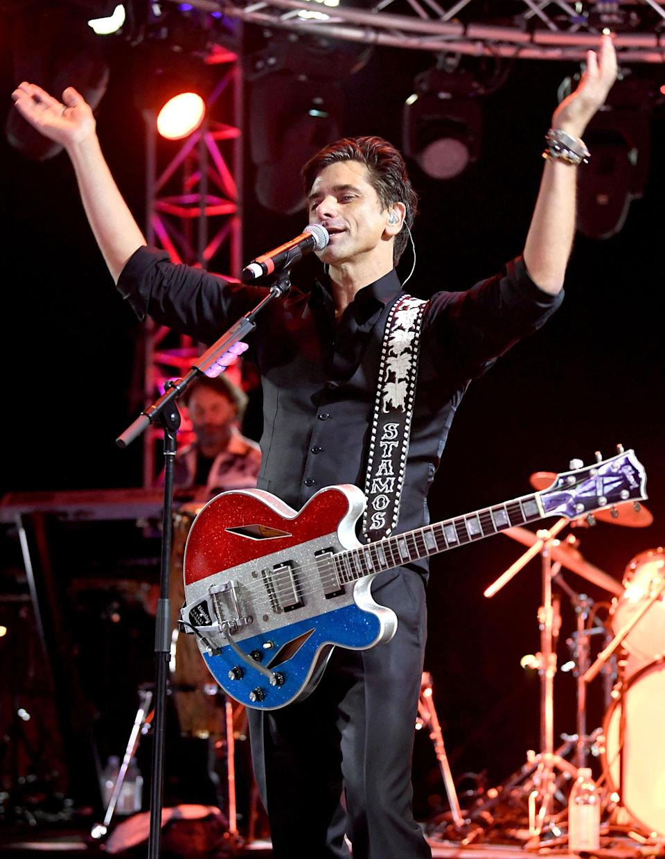 <p>John Stamos performed onstage during the Concerts In Your Car's The Beach Boys' Drive-in event at Ventura County Fairgrounds in California.</p>