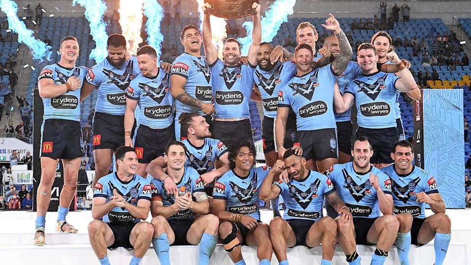NSW players, pictured here celebrating with the State of Origin shield.