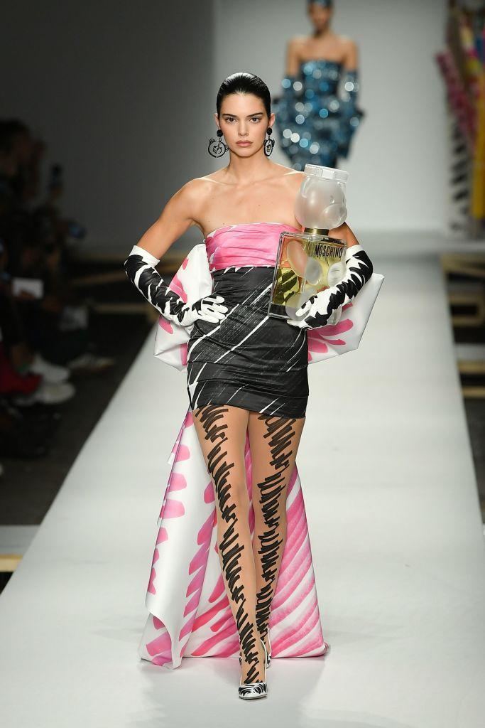 <p>Model Kendall Jenner carries a giant perfume bottle during Moschino's Spring/Summer 2019 fashion show during Milan Fashion Week on Sept. 20. (Photo: Marco Bertorello/AFP/Getty Images) </p>
