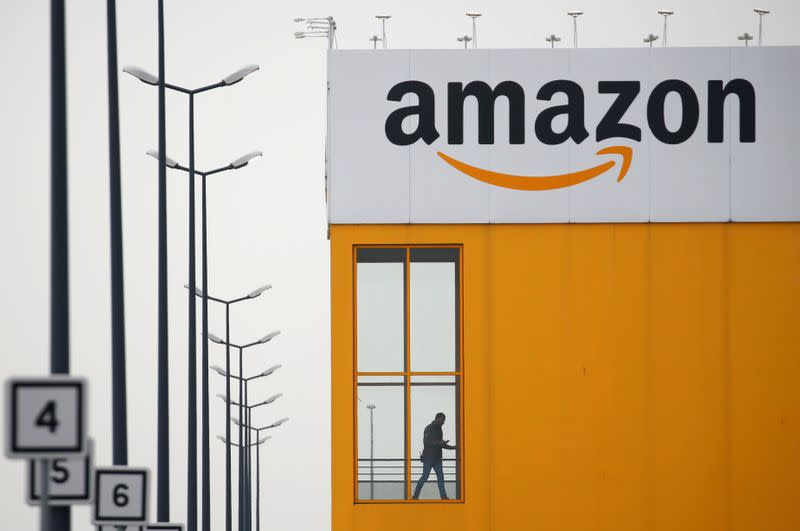 FILE PHOTO: The logo of Amazon is seen at the company logistics center in Lauwin-Planque