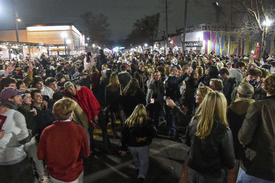 Alabama fans celebrate in the street in Tuscaloosa, Ala.