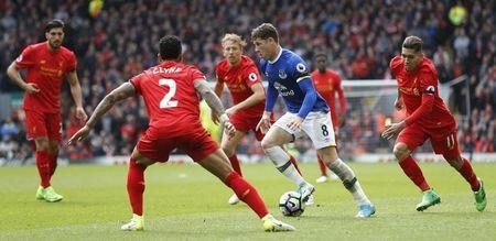 Britain Soccer Football - Liverpool v Everton - Premier League - Anfield - 1/4/17 Everton's Ross Barkley in action with Liverpool's Lucas Leiva (C), Nathaniel Clyne and Roberto Firmino (R) Action Images via Reuters / Carl Recine Livepic