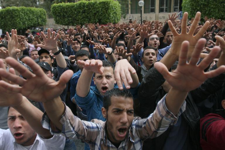 Students from Cairo University demonstrate in support of Mohamed Morsi on the campus on March 19, 2014
