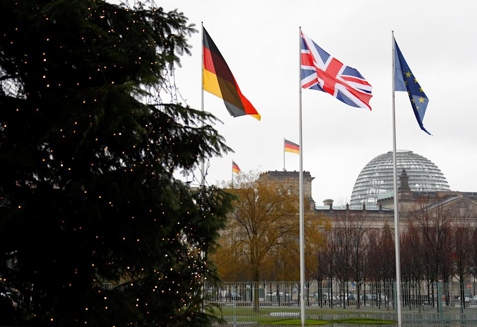 German, British, and EU flags in front of the Reichstag in Berlin, Germany. Photo: Reuters/Fabrizio Bensch