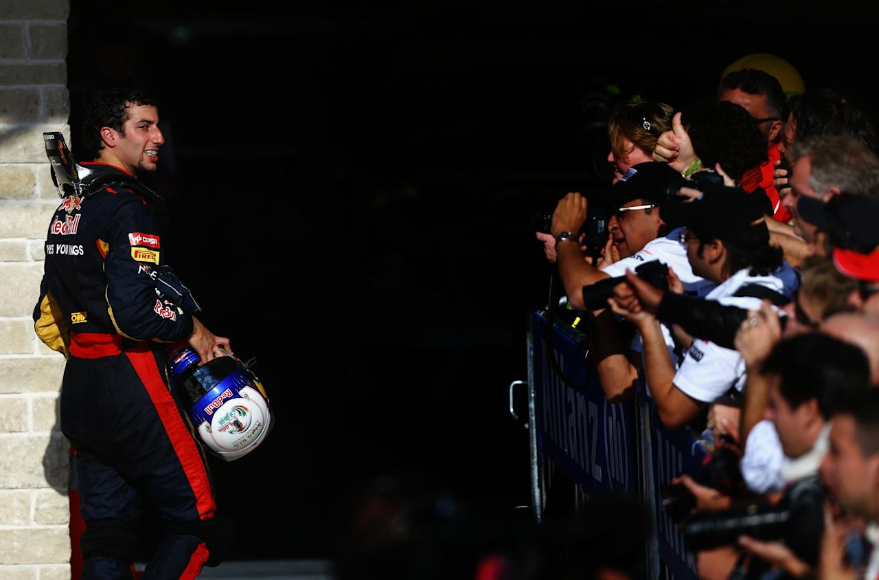 AUSTIN, TX - NOVEMBER 18:  Daniel Ricciardo of Australia and Scuderia Toro Rosso makes his way through parc ferme after the United States Formula One Grand Prix at the Circuit of the Americas on November 18, 2012 in Austin, Texas.  (Photo by Paul Gilham/Getty Images)