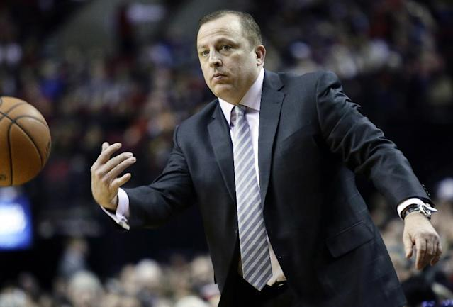 Chicago Bulls coach Tom Thibodeau flips an out-of-bounds ball to the referee during the first half of an NBA basketball game against the Portland Trail Blazers in Portland, Ore., Friday, Nov. 22, 2013. (AP Photo/Don Ryan)