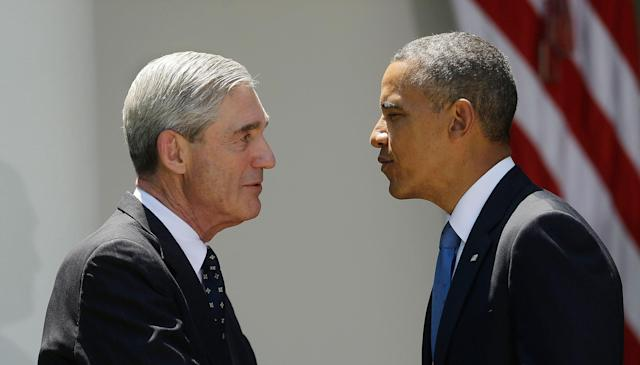 <p>President Barack Obama, right, with outgoing FBI Director Robert Mueller, left, during Obama's announcement at he will nominate James Comey, a senior Justice Department official under President George W. Bush, to replace Mueller, as director of the F.B.I., in the Rose Garden of the White House on Friday, June 21, 2013, in Washington. (Photo: Pablo Martinez Monsivais/AP) </p>