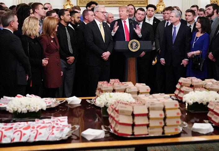 Donald Trump welcomed the North Dakota State Bison football team to the White House with a spread of French fries, chicken sandwiches and burgers on March 4, 2019 (AFP Photo/MANDEL NGAN)