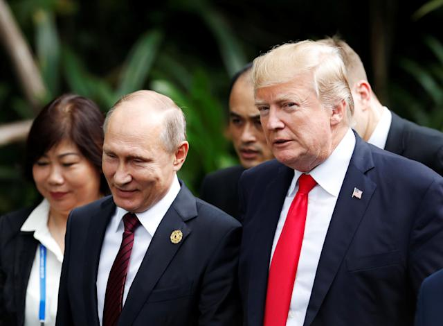 President Donald Trump and Russia's President Vladimir Putin attend a photo session at a summit in Vietnam on Saturday.