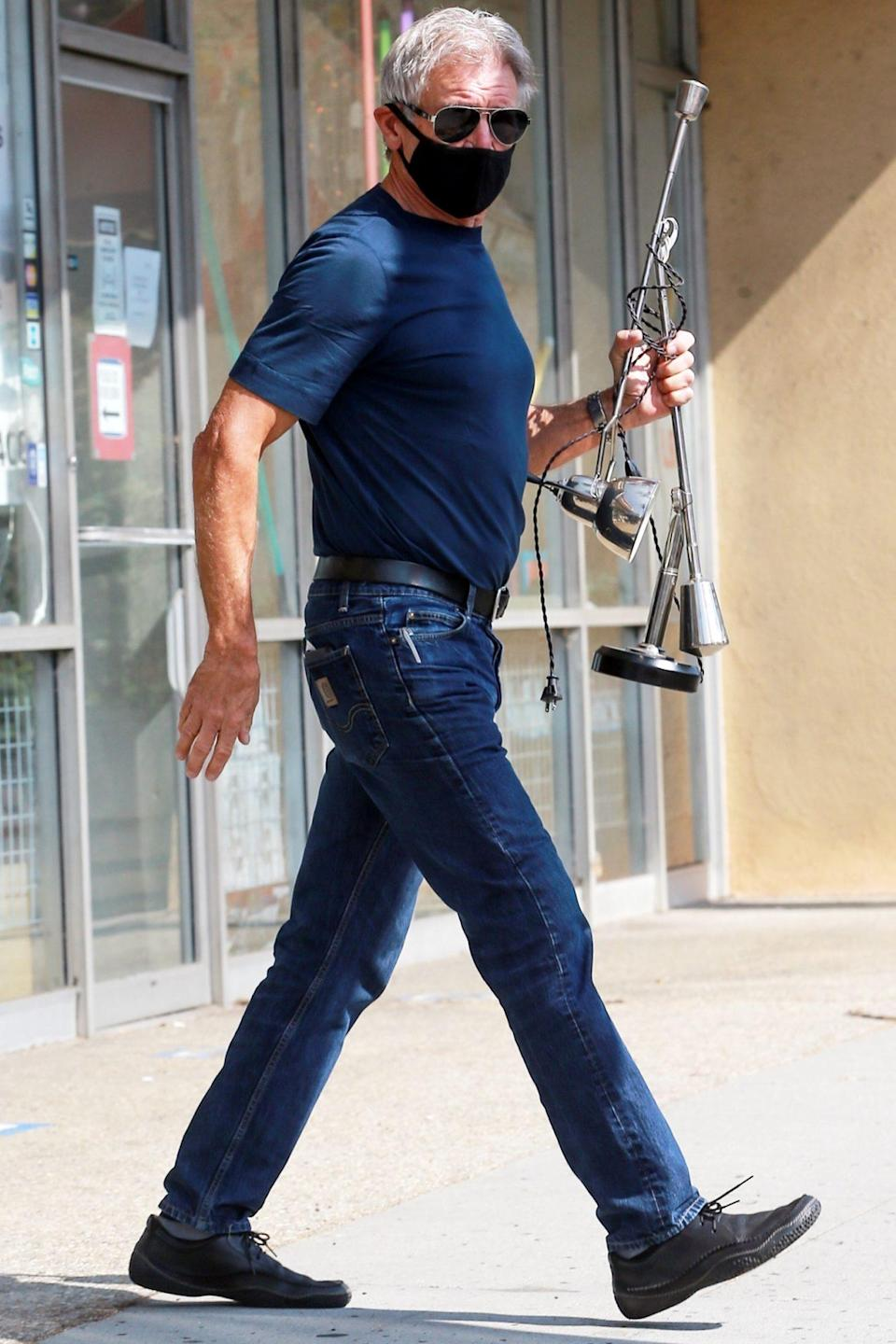 <p>Harrison Ford is seen bringing a broken desk lamp to a Light Bulbs Unlimited for repair in Santa Monica on Wednesday.</p>