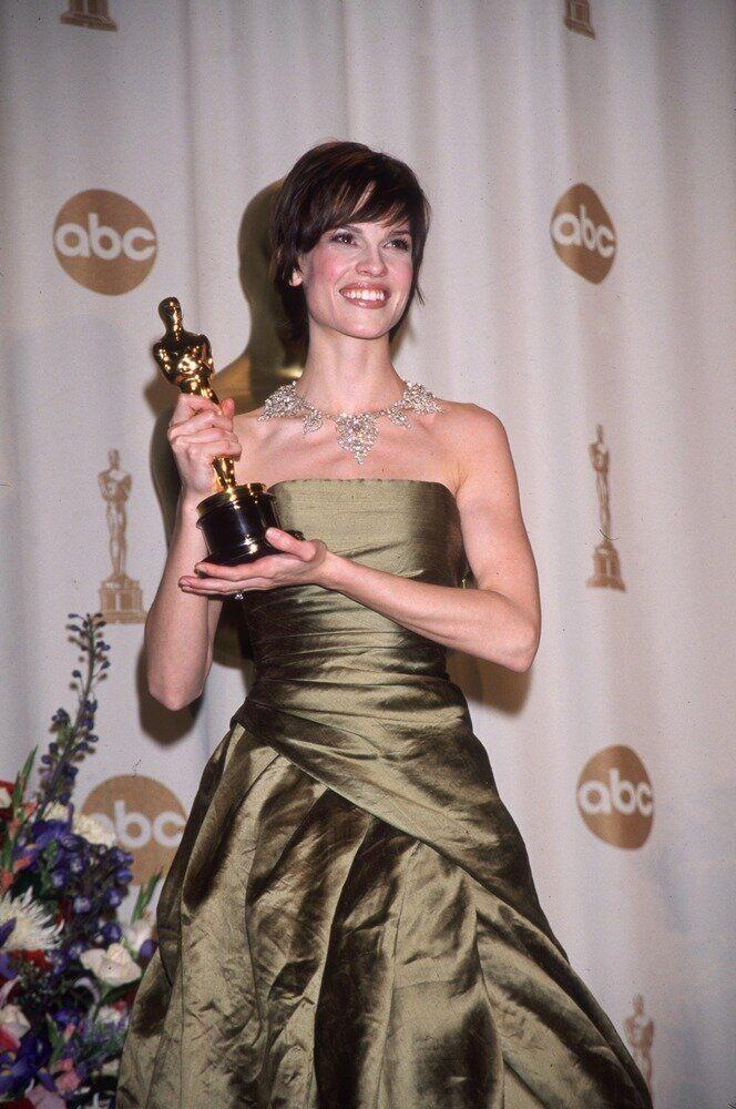 "The actress posing with her Oscar after winning for her role in ""Boys Don't Cry."""