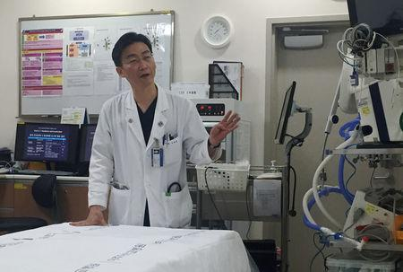 FILE PHOTO: Lee Cook-jong, a South Korean surgeon who operated the defected North Korean soldier with gunshots, speaks during an interview with Reuters at a hospital in Suwon