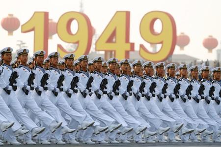 Soldiers of People's Liberation Army (PLA) march in formation past Tiananmen Square during a rehearsal before a military parade marking the 70th founding anniversary of People's Republic of China