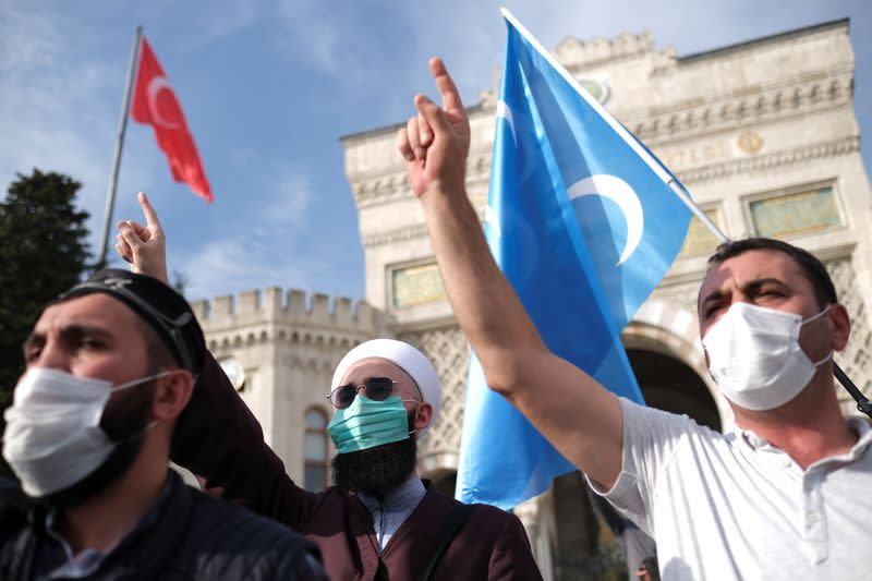 Demonstrators shout slogans during a protest against France, in Istanbul