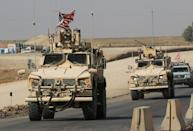 A convoy of U.S. vehicles is seen after withdrawing from northern Syria, at the Iraqi-Syrian border crossing in the outskirts of Dohuk