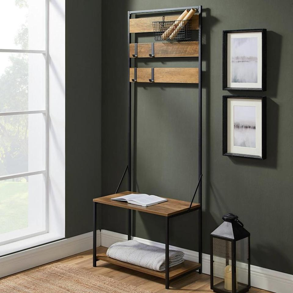 """Winter is coming. Organize your coats, hats, umbrellas, keys and evenface maskson <a href=""""https://fave.co/31JEvKA"""" target=""""_blank"""" rel=""""noopener noreferrer"""">this reclaimed barn wood entryway organizer</a>. It includes four moveable hooks so you can get the right setup for your family. It also includes a removable wire basket you could use to store clean cloth face masks, gloves, umbrellas or more. It also has a special waterproof coating so you don't have to worry about rain or snow ruining the finish. Mount a mirror beside it and you have the perfect setup to check yourself on your way out the door. <a href=""""https://fave.co/31JEvKA"""" target=""""_blank"""" rel=""""noopener noreferrer"""">Originally $178, get it now for $140 at The Home Depot</a>."""