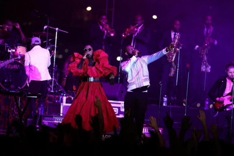 The Fugees performed on Wednesday for Global Citizen, kicking off a world tour that marks 25 years since their seminal album 'The Score'. (AFP/Theo Wargo)