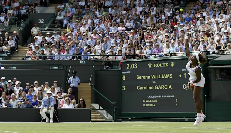 Serena Williams of the United States serves to Caroline Garcia of France during their Women's second round singles match at the All England Lawn Tennis Championships in Wimbledon, London, Thursday, June 27, 2013. (AP Photo/Alastair Grant)
