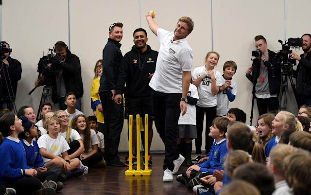 <span>Joe Root bowls as the Dore Primary School pupils watch on</span> <span>Credit: GETTY IMAGES </span>