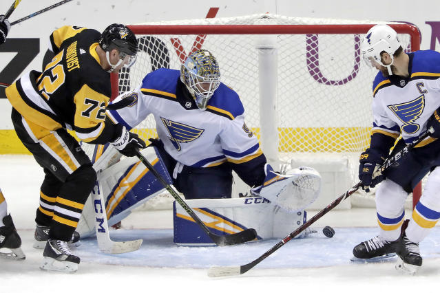 Pittsburgh Penguins' Patric Hornqvist (72) can't get a shot past St. Louis Blues goaltender Jordan Binnington (50) with Alex Pietrangelo defending during the third period of an NHL hockey game in Pittsburgh, Saturday, March 16, 2019. The Blues won 5-1. (AP Photo/Gene J. Puskar)