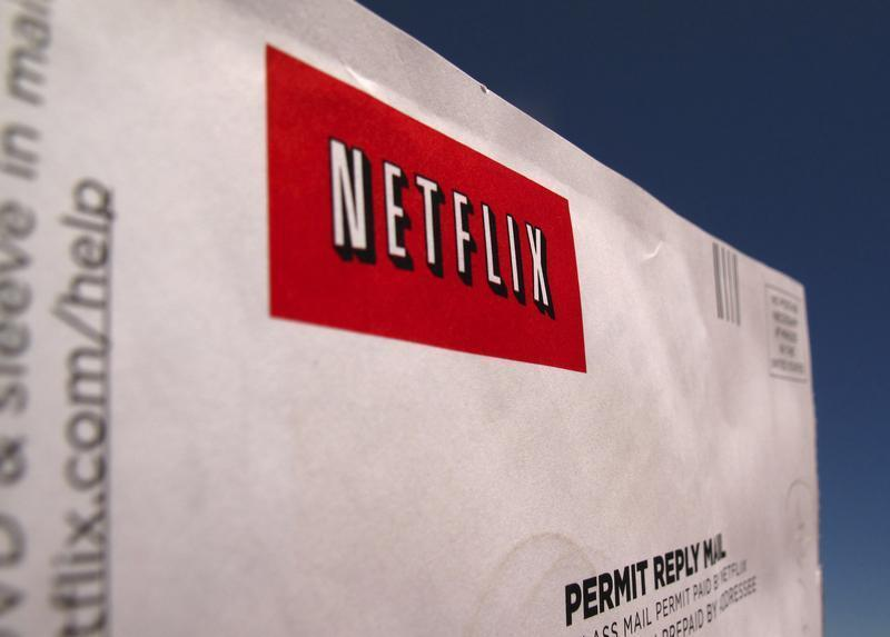A Netflix return CD mail envelope is shown in Encinitas, California