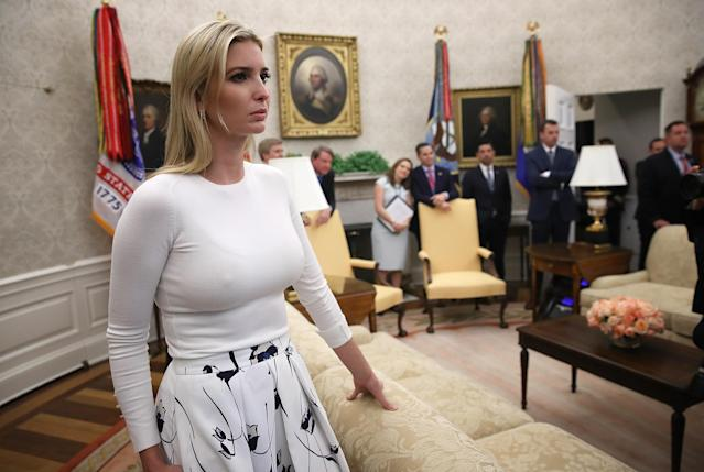 Ivanka Trump, daughter of President Trump, watches as he answers questions after signing an executive order on Wednesday in Washington, D.C., to end the practice of separating family members who are apprehended while illegally entering the U.S. (Photo: Win McNamee/Getty Images)