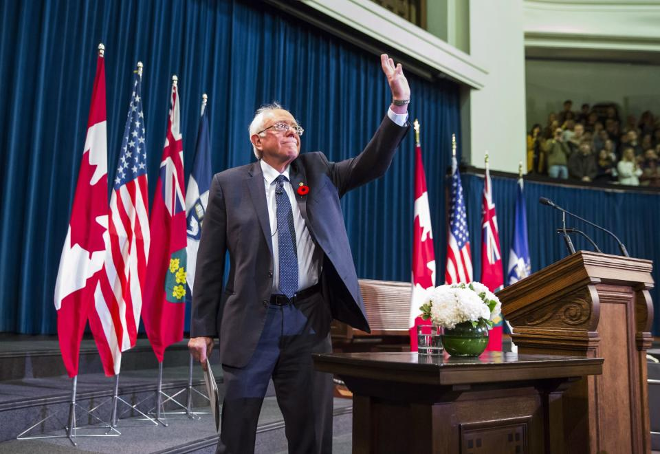 U.S. Senator Bernie Sanders waves to the crowd at the University of Toronto during his visit to Toronto. Photo from CP Images