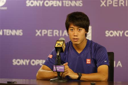 Mar 28, 2014; Miami, FL, USA; Kei Nishikori speaks at a press conference announcing his withdrawal from his match against Novak Djokovic (not pictured) in the men's singles semi final of the Sony Open at Crandon Tennis Center. Geoff Burke-USA TODAY Sports