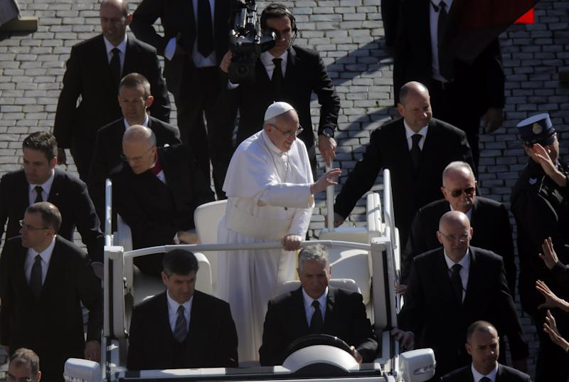Pope Francis waves upon his arrival in St. Peter's Square for his inaugural Mass, at the Vatican, Tuesday, March 19, 2013. (AP Photo/Dmitry Lovetsky)