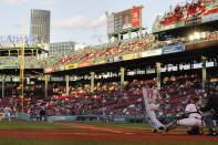 Los Angeles Angels' Shohei Ohtani follows through on a double against the Boston Red Sox during the first inning of a baseball game Friday, May 14, 2021, at Fenway Park in Boston. (AP Photo/Winslow Townson)