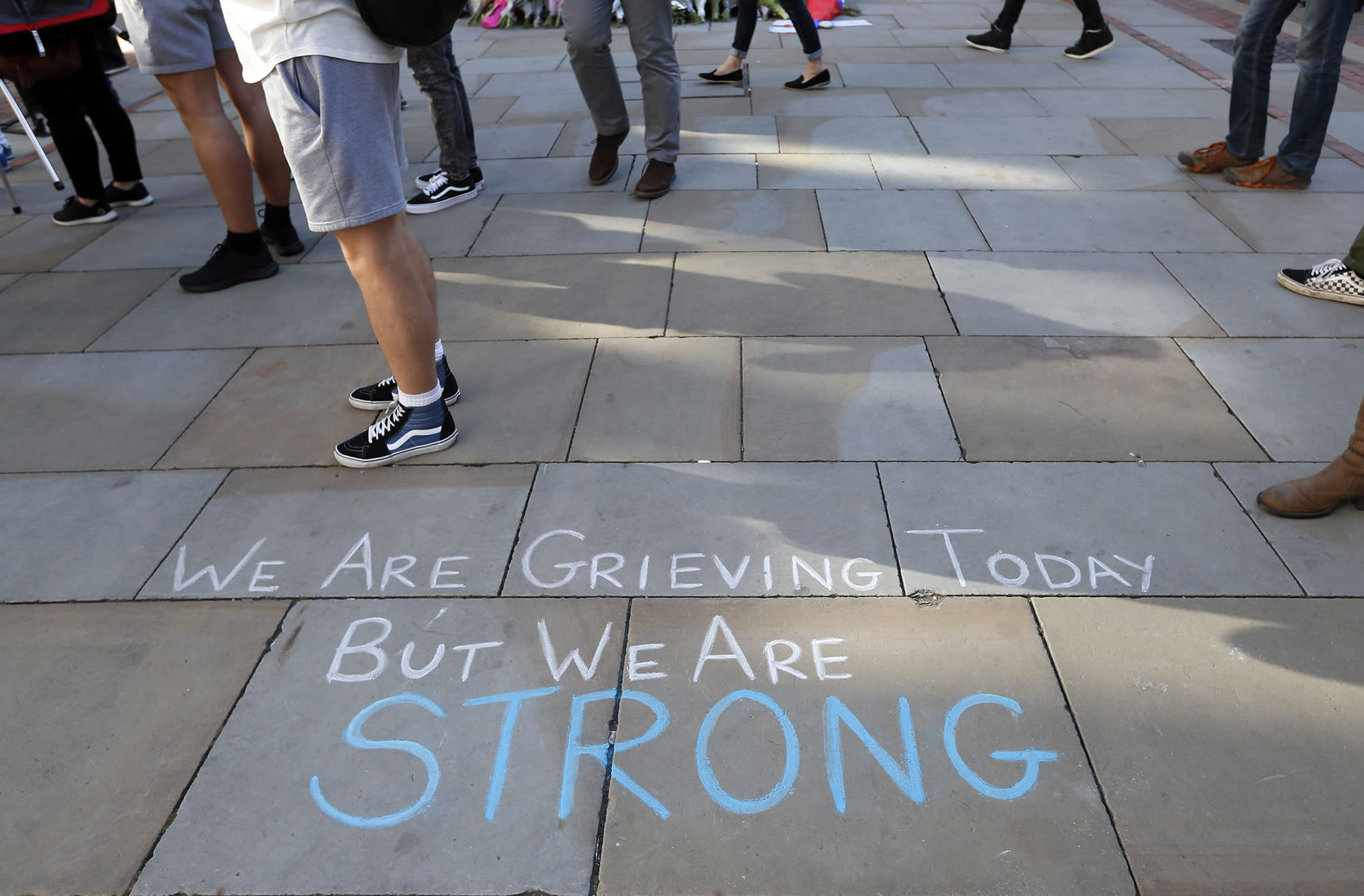 A message is written on the pavement in Manchester, England, Tuesday May 23, 2017, the day after the suicide attack at an Ariana Grande concert that left 22 people dead as it ended on Monday night. (Photo: Kirsty Wigglesworth)