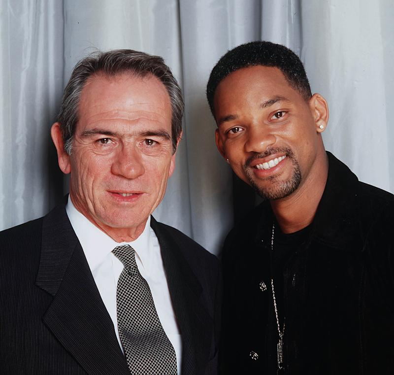 "LONDON - JULY 17: American actors Tommy Lee Jones (L) and Will Smith (R) promote their film ""Men in Black 2"" at Claridges Hotel on July 17, 2002 in London. (Photo by Dave Hogan/Getty Images)"