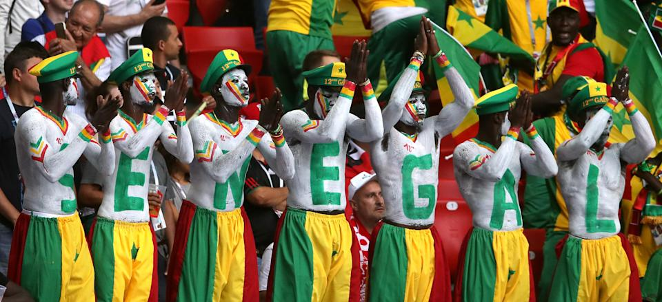<p>Senegal fans made a huge effort with this coordinated offering. Just make sure you always sit in that order… (Getty) </p>