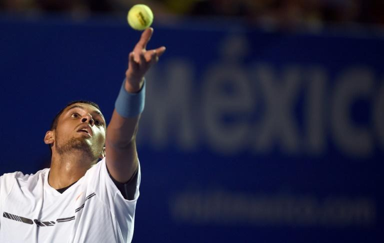 Australia's Nick Kyrgios serves to Serbia's Novak Djokovic in the quarter-finals of the Mexico Open in Acapulco on March 2, 2017