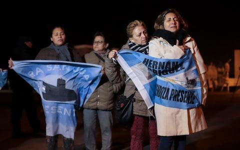 Relatives of the crew of the ARA San Juan submarine wait outside the navy base in Mar del Plata - Credit: AP Photo/Federico Cosso